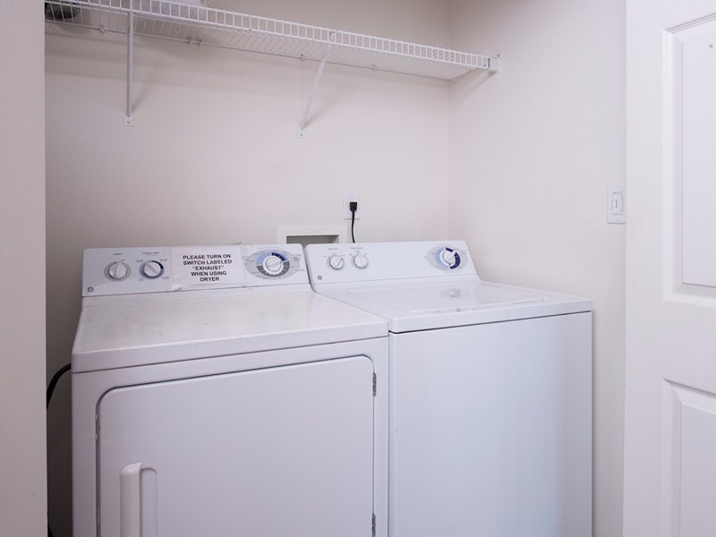 Full Size Washer and Dryer.  Iron and Ironing Board.