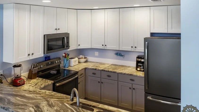 Kitchen with granite and black stainless appliances