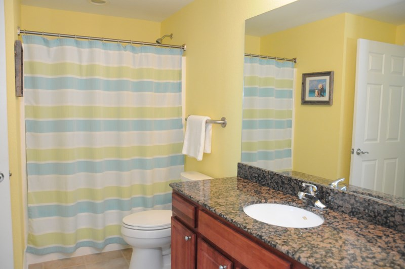Guest Bathroom with Single Sink, Granite Counter Top and Comfort Toilet