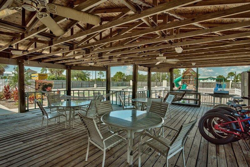 Outdoor patio hang out area. Play ground for kids, Putt Putt Course and basketball court.