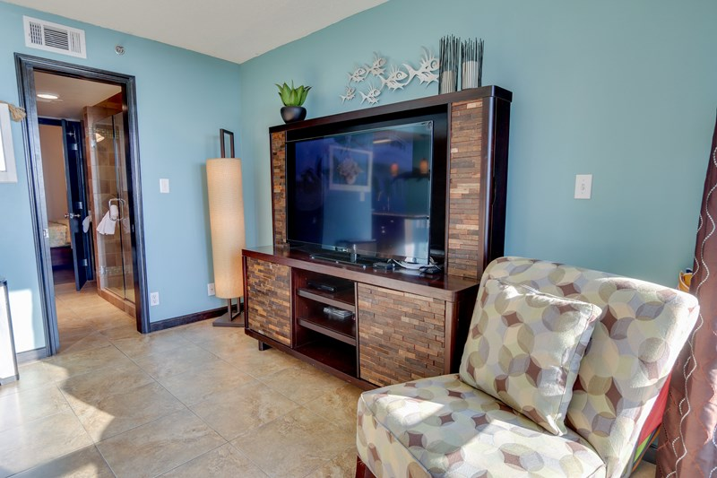 LARGE tv and comfortable seating, tile floor throughout