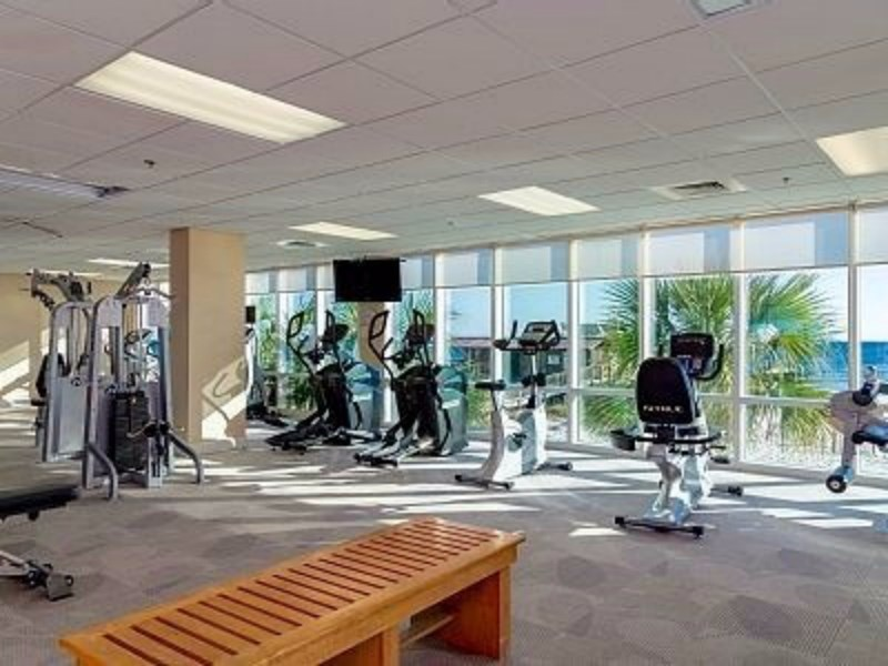 Fitness Center with Sauna, free weights, treadmills, and other machines. Shower area.  Look out over the gulf as you work out
