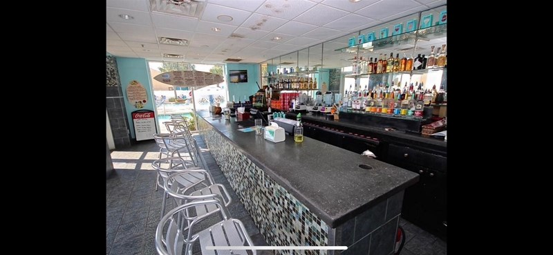 H2O Bar and Grill. Delicious food and drinks. Market also available for ice cream, deli, and Starbucks