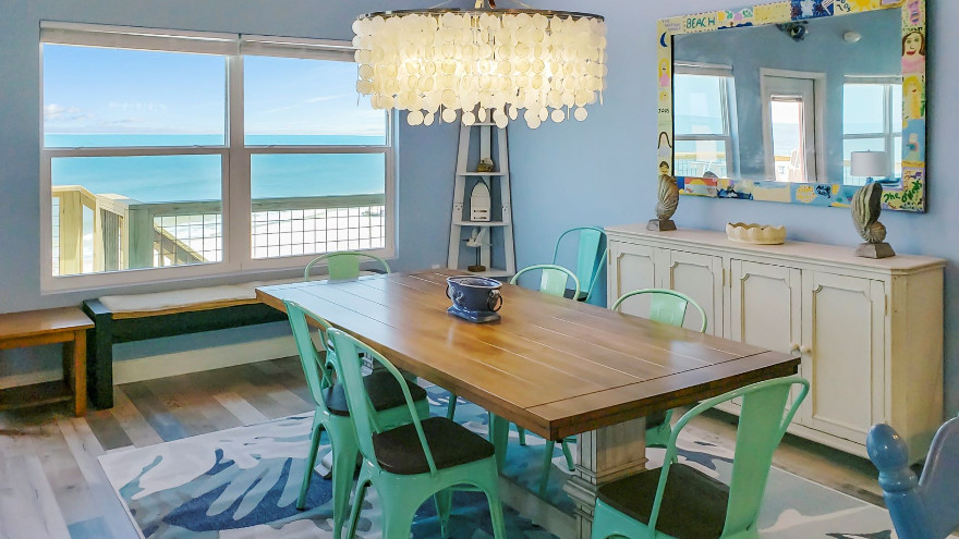 Dining room with shell chandelier and ocean views!